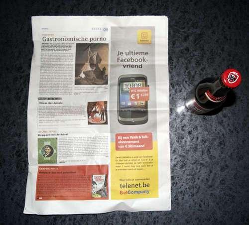 53355680 - Como abrir una botella de cerveza con una hoja de periódico o un billete